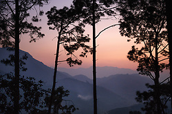 Sunset through the trees in the Kagati village.<br />  <br /> The 2015 earthquakes devastated Nepal and left girls and women in an increasingly vulnerable position, leading experts to believe child marriage rates will increase over the coming years.