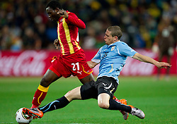 Kwadwo Asamoah of Ghana vs Diego Perez of Uruguay during to the 2010 FIFA World Cup South Africa Quarter Finals football match between Uruguay and Ghana on July 02, 2010 at Soccer City Stadium in Sowetto, suburb of Johannesburg. (Photo by Vid Ponikvar / Sportida)