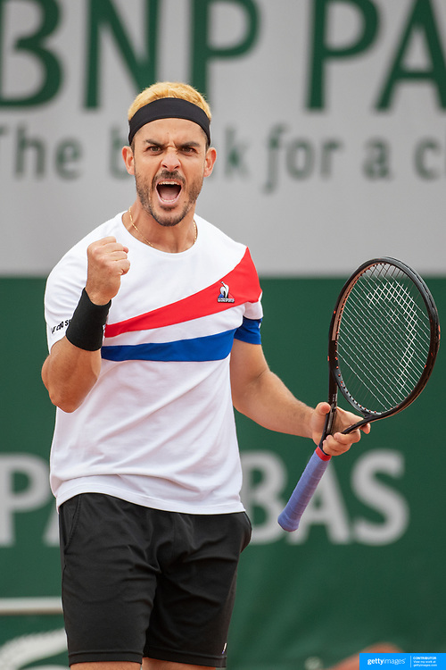 PARIS, FRANCE May 24.  Thomas Fabbiano of Italy reacts during his victory against Christopher Eubanks of the United States on court six on the first day of the qualifying tournament at the 2021 French Open Tennis Tournament at Roland Garros on May 24th 2021 in Paris, France. (Photo by Tim Clayton/Corbis via Getty Images)