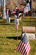 11 NOVEMBER 2020 - DES MOINES, IOWA: dMIKE ROWLEY, (left) and ALAN WENGER, members of Sons of the Revolution, read the names of veterans buried in Woodland Cemetery during the Veterans' Day service in Woodlawn Cemetery in Des Moines. Volunteers read the names of the approximately 1,000 veterans buried in the cemetery. The observance at Woodland Cemetery was one of the few live Veterans Day ceremonies in the Des Moines area this year. Most were held online only because of the Coronavirus pandemic.  PHOTO BY JACK KURTZ