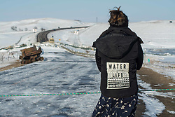 December 3, 2016 - A water protector is parying at the barricade set by North Dakota police (Credit Image: © Dimitrios Manis via ZUMA Wire)