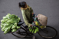Hanoi Street Vendor Veg - Street Vendors, Hanoi Old Quarter - In Hanoi, life is convenient for shoppers, especially housewives. . No matter where you are, you can easily get anything you need from ubiquitous street vendors. They can make their living by carrying a yoke - baskets slung from each end of a bamboo pole, or from the back of a bicycle. Street vendors are everywhere  in Hanoi. They are up before sunrise, carrying and peddling everything from baguettes to brooms to baskets.