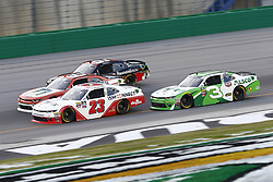 July 13, 2018 - Sparta, Kentucky, United States of America - Spencer Gallagher (23), Ty Dillon (3), Joey Gase (35) and Jeremy Clements (51) battle for position during the Alsco 300 at Kentucky Speedway in Sparta, Kentucky. (Credit Image: © Chris Owens Asp Inc/ASP via ZUMA Wire)