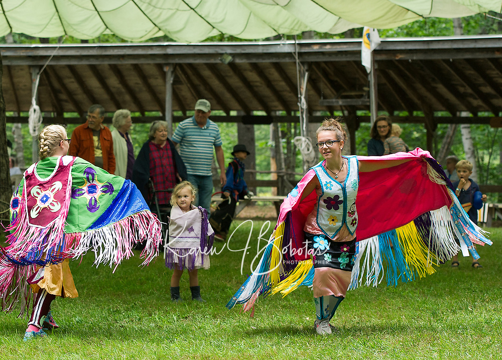 Meadow Chase and Alexis Sutherland dance in their fancy regalia during the Inter Tribal dance on Saturday afternoon at the 48th annual Labor Day Pow Wow with Laconia Indian Historical Association in Sanbornton.  (Karen Bobotas/for the Laconia Daily Sun)