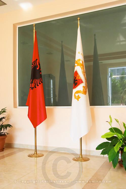 At the entrance to the winery, the Albanian flag and the flag of the winery. Kantina e Pijeve Gjergj Kastrioti Skenderbeu Skanderbeg winery, Durres. Albania, Balkan, Europe.