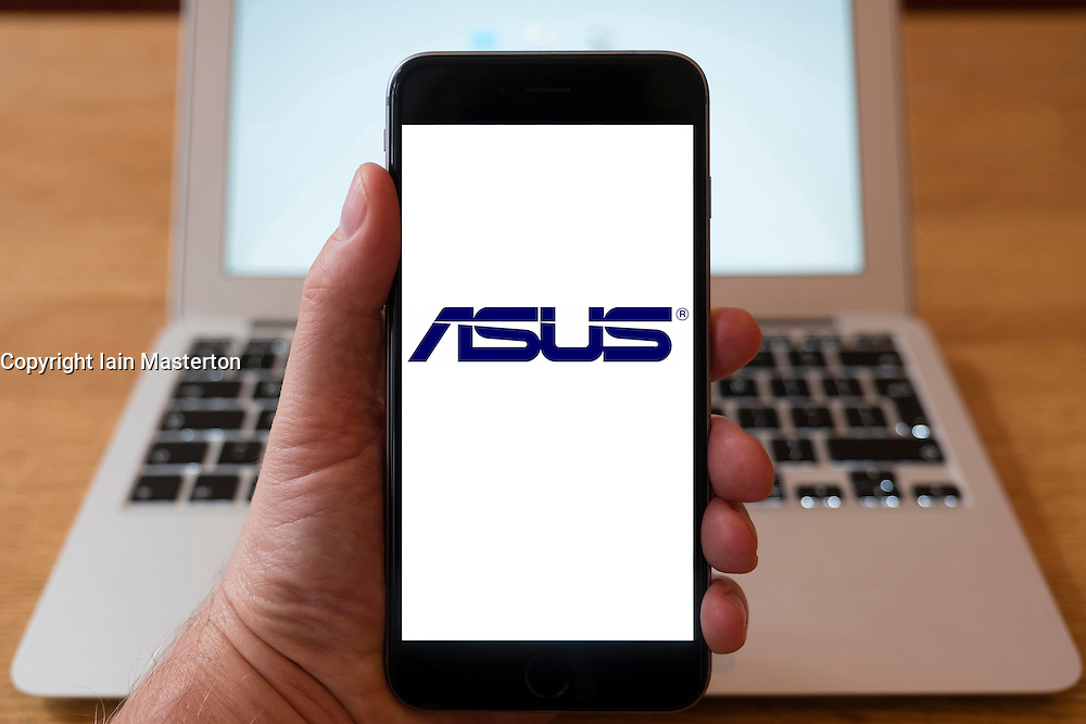 Using iPhone smartphone to display logo of ASUS computer company