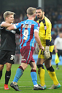 Paddy Madden of Scunthorpe United takes issue with Nick Townsend of Barnsley FC during the Sky Bet League 1 match between Scunthorpe United and Barnsley at Glanford Park, Scunthorpe, England on 31 October 2015. Photo by Ian Lyall.