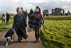Salisbury, UK. 5th December, 2020. Over one hundred people, including local residents, climate and land justice activists and pagans, take part in a Mass Trespass at Stonehenge. The trespass was organised in protest against the approval by Transport Secretary Grant Shapps of a £1.7bn project for a two-mile tunnel beneath the World Heritage Site and a further eight miles of dual carriageway for the A303, as well as the government's £27bn Road Investment Strategy 2 (RIS2).