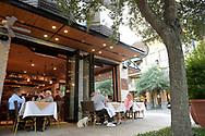 Diners sit outside a restaurant along Park Ave. in Winter Park, Fla., Wednesday, Oct. 28, 2015. (Phelan M. Ebenhack via AP)