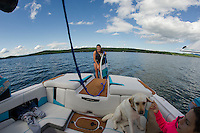 Not your typical surfing spot but Julia Cantin grabs her board for an evening of wake surfing from her family's boat on Lake Winnisquam.  (Karen Bobotas/for the Laconia Daily Sun)
