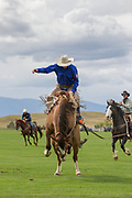 Saddle Bronc riding at the Don King Days Rodeo in Sheridan, Wyoming