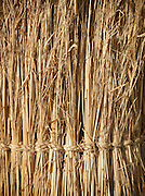 Bound reeds are used as thatch for huts roofing, in Rhumsiki, Cameroon