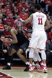 20 March 2017:  A.J. Davis trapped in the corner by MiKyle McIntosh(11) during a College NIT (National Invitational Tournament) 2nd round mens basketball game between the UCF (University of Central Florida) Knights and Illinois State Redbirds in  Redbird Arena, Normal IL