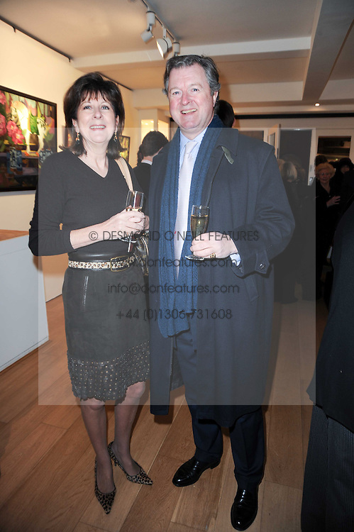 The EARL & COUNTESS OF BALFOUR at a private view of recent paintings, drawings and prints by Dione Verulam (Countess of Verulam) held at Sladmore Contemporary art gallery, 32 Bruton Place, London on 10th February 2010.
