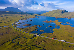 Aerial view of Lochan na h-Achlaise and A82 road crossing Rannoch Moor in summer, Scotland, UK