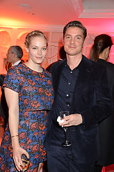 MAX BROWN and his wife ANNABELLE HORSEY at the Fortnum & Mason and Quintessentially Foundation Fayre of St.James's in association with The Crown Estate held at St.James's Church, Piccadilly followed but a reception at Fortnum & Mason, Piccadilly,London on 5th December 2013.