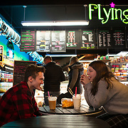 Jack Johnson and Hanna Wolf enjoy a treat at the Flying Pig Treat Shop in downtown Beloit, Wisconsin. Nathan Lambrecht/Journal Communications