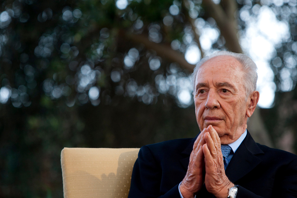 """A Portrait of Israeli President Shimon Peres, during President's Award for Volunteerism ceremony, held at the president's residence in Jerusalem on August 9, 2010. The """"Presidential Award for Volunteerism"""" is the most prestigious award in the field of volunteering, given each year by the President of the State of Israel to 12 winners. The aim of this award is to recognize the work done by individuals and groups in all sectors of the populations and to encourage the spirit of voluntarism in Israel's society."""
