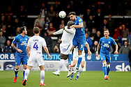 Peterborough Utd defender Ryan Tafazolli (5) climbs above Wycombe forward Adebayo Akinfenwa (20) during the EFL Sky Bet League 1 match between Peterborough United and Wycombe Wanderers at London Road, Peterborough, England on 2 March 2019.