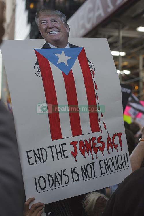 October 3, 2017 - New York City, New York, United States - People rally outside of Trump Tower in support of Puerto Rico on the day that President Donald Trump visited the island, parts of which were devastated by Hurricane Maria on October 3, 2017 in New York City. The protesters were critical of the Trump administration's response to the storm. Thousands of Puerto Ricans are still without electricity and water twelve days after the storm. (Credit Image: © Shay Horse/NurPhoto via ZUMA Press)