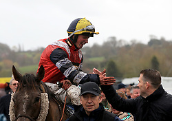 Jockey James Bowen celebrates after winning the Marstons 61 Deep Midlands Grand National race onboard Potters Corner at Uttoxeter Racecourse.
