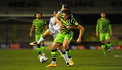 Josh Davison of Forest Green Rovers is held back by Tommy Smith of Colchester United- Mandatory by-line: Nizaam Jones/JMP - 27/02/2021 - FOOTBALL - The innocent New Lawn Stadium - Nailsworth, England - Forest Green Rovers v Colchester United - Sky Bet League Two