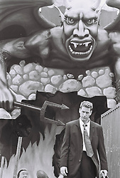 Man in a suit at the Coney Island funhouse