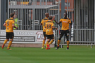Ismail Yakubu of Newport county ® celebrates after scoring his side's first goal. Skybet football league two match, Newport county v AFC Wimbledon at Rodney Parade in Newport, South Wales on Saturday 27th Sept 2014<br /> pic by Mark Hawkins, Andrew Orchard sports photography.