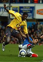 Photo: Ed Godden.<br /> Portsmouth v Arsenal. The Barclays Premiership. 12/04/2006. Emmanuel Adebayor (L) is tackled by Pompeys Pedro Mendes.