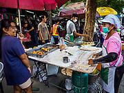 07 NOVEMBER 2017 - BANGKOK, THAILAND: A couple that sells pa tong go (Chinese friend dough, like a Chinese churro or donut) at a local market on Ekkamai Soi 30 in Bangkok.      PHOTO BY JACK KURTZ