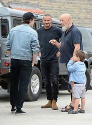 David Beckham (centre), Brooklyn Beckham (left), Michael Eavis and his grandson Noah celebrate a completed housing development in Pilton village in Somerset.