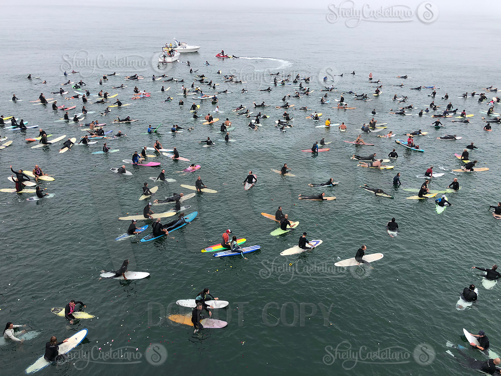 28 August 2021:  Rockin Fig paddle out memorial northside HB.  iPhone ©SCPIX
