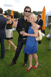 Actor RAIFE BURCHELL and actress EVA BIRTWISTLE at the final of the Veuve Clicquot Gold Cup 2007 at Cowdray Park, West Sussex on 22nd July 2007.<br /><br />NON EXCLUSIVE - WORLD RIGHTS