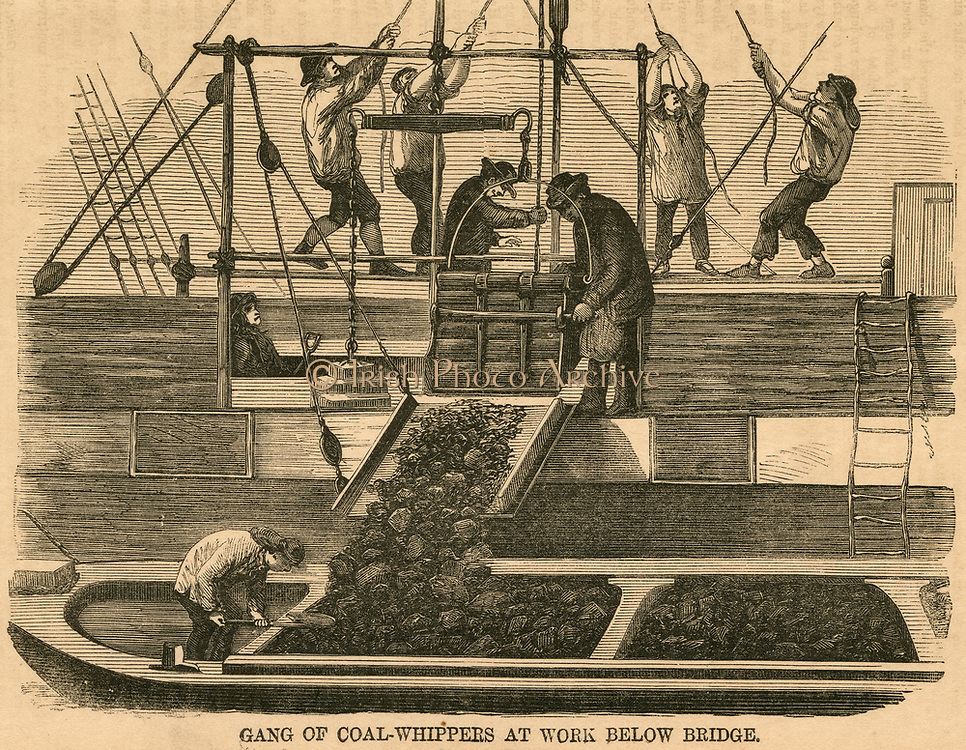 Unloading coal in London docks transferring the cargo into a typical Thames lighter. Engraving, 1866.