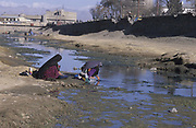 Women washing clothes in the dried-up river Kabul. This was forbidden by the Taliban.