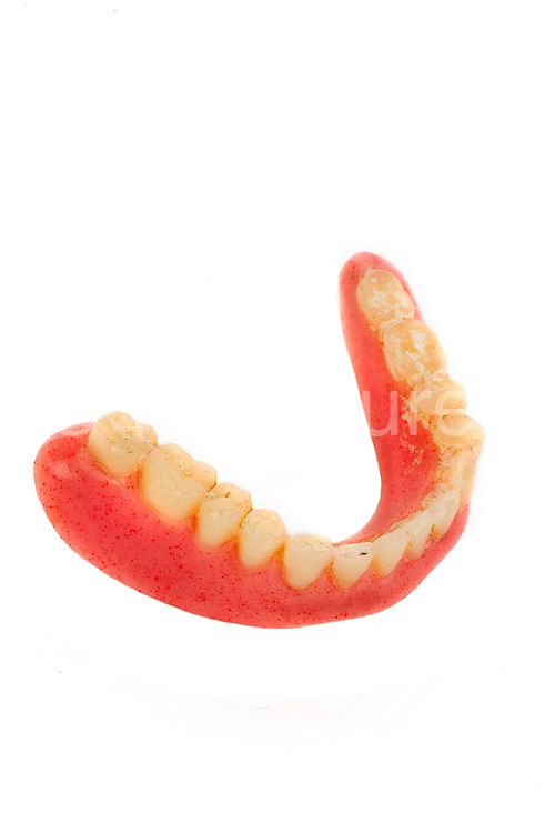False teeth left on public transport, held in the Lost Property office of London Transport. About 184,000 items are left on London public transport systems every year, and they do the best they can to reunite passengers with their lost belongings!
