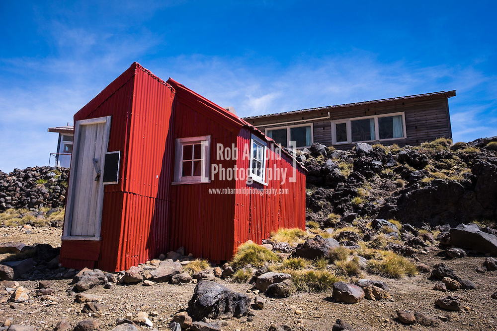 """Glacier Hut on Mount Ruapehu. The sign on the door read """"First hut on these snowfields built by the Ruapehu Ski Club in 1923 and preserved in memory of our mountain pioneers"""""""