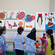 Art work made by children on display in Rashidieh refugee camp after a week of Play and Learn with Naba'a. Developmental Action Without Borders(Naba'a) work in Palestinian refugee camps across Lebanon to help children in the camps.  The camps are densely over-crowded and many of the children are 4th generation refugees living in Lebanon with no citizenship or rights and under immense pressure. Naba'a is a mix of Palestinians and Lebanese and aim to give children a sense of security and freedom to express their needs and rights.Naba'a operates in communities governed by a multitude of political parties and religious groups and Naba'a keeps a strict independed line from any affiliation with any groups.