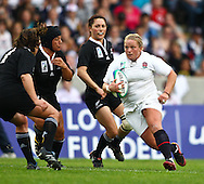 5th September 2010, Twickenham Stoop, London, England: Amy Turner of England heads into a tackle during the IRB Women's Rugby World Cup final between England and New Zealand Black Ferns. New Zealand won 13-10, capturing the trophy for the 4th time.  (Photo by Andrew Tobin www.slikimages.com)