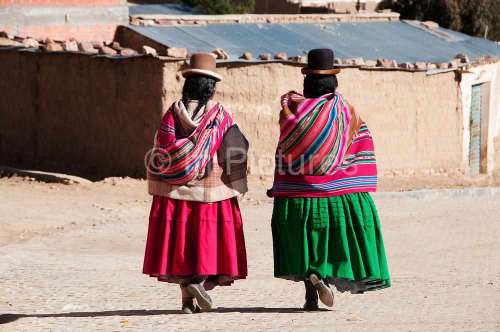Bolivia June 2013. Cajamarca. Meeting with women. Two Aymara women walking home.