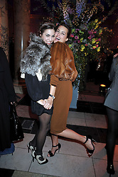 Left to right, AMBER LE BON and her mother YASMIN LE BON at Hats - an antology of Stephen Jones held at the V&A, London on 23rd February 2009.