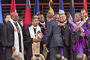 U.S. President Barack Obama greets Bishops from the AME Church before delivering the eulogy at the funeral of slain State Senator Clementa Pinckney at the TD Arena June 24, 2015 in Charleston, South Carolina. Pinckney is one of the nine people killed in last weeks Charleston church massacre.