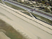 Nederland, Noord-Holland, Zandvoort; 23-03-2020; ondanks het mooie voorjaarsweer liggen de stranden van Zandvoort er verlaten bij door de corona crisis. Niet alleen is alle horeca dicht, ook veel winkels en andere bedrijven zijn gesloten. De parkeerplaatsen zijn afgesloten na de grote drukte om verspreiding van het Corona virus te voorkomen.<br /> Despite the beautiful spring weather, the beaches of Zandvoort are deserted due to the corona crisis. Not only is all catering closed, many shops and other companies are also closed. The parking spaces are closed to prevent the spread of the Corona virus.<br /> <br /> luchtfoto (toeslag op standaard tarieven);<br /> aerial photo (additional fee required)<br /> copyright © 2020 foto/photo Siebe Swart