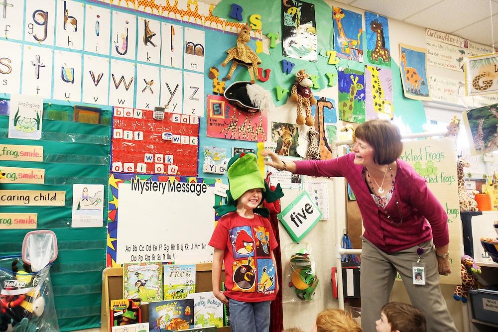 Diane Bonica, longtime kindergarten teacher at Deer Creek Elementary School in Tigard, works with William Schmidt and this year's crop of children on Wednesday, May 23, 2012.