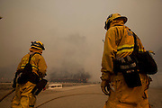 Firefighters keep watch the wildfire in the Naval Base at Point Mugu Friday, May 3, 2013..(AP Photo/Ringo H.W. Chiu)