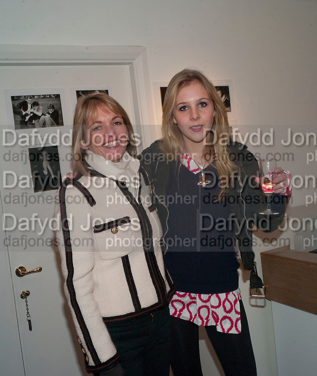 LUCINDA GARLAND; ELIZA HENDERSON, The Way We Wore.- Photographs of parties in the 70's by Nick Ashley. Sladmore Contemporary. Bruton Place. London. 13 January 2010. *** Local Caption *** -DO NOT ARCHIVE-© Copyright Photograph by Dafydd Jones. 248 Clapham Rd. London SW9 0PZ. Tel 0207 820 0771. www.dafjones.com.<br /> LUCINDA GARLAND; ELIZA HENDERSON, The Way We Wore.- Photographs of parties in the 70's by Nick Ashley. Sladmore Contemporary. Bruton Place. London. 13 January 2010.