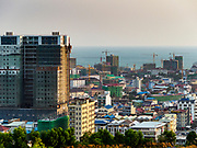 """13 FEBRUARY 2019 - SIHANOUKVILLE, CAMBODIA:  Casinos under construction in Sihanoukville. There are about 80 Chinese casinos and resort hotels open in Sihanoukville and dozens more under construction. The casinos are changing the city, once a sleepy port on Southeast Asia's """"backpacker trail"""" into a booming city. The change is coming with a cost though. Many Cambodian residents of Sihanoukville  have lost their homes to make way for the casinos and the jobs are going to Chinese workers, brought in to build casinos and work in the casinos.      PHOTO BY JACK KURTZ"""