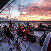 Leg 4, Melbourne to Hong Kong, day 18 on board MAPFRE, one of the lasts sun rise until arrive to Hong Kong, Joan Vila, Guillermo Altadill, Pablo Arrarte and Xabi fernandez on deck. Photo by Ugo Fonolla/Volvo Ocean Race. 18 January, 2018.