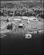 "Ackroyd 19391-2 ""Shaver Transportation Co. Schnitzer Industries. Aerial Floating Marine Ways. July 21, 1975""  (Port Services Co., 9125 N. Bradford St., St Johns. 2 blocks north of St. Johns Bridge. Ship repair yard on Willamette River.)"