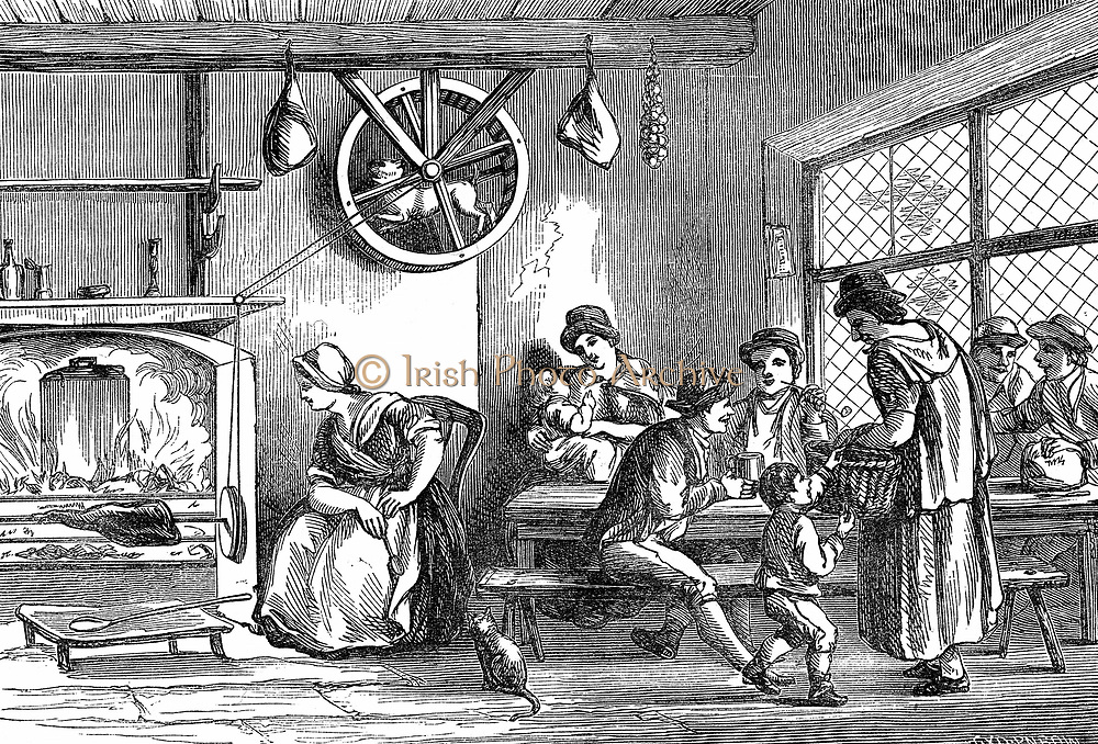Turnspit dog at work in the inn at Newcastle, Carmarthen, Wales, c1800. These short-legged dogs were bred especially to work in wheels turning cooking spits. By 1800 the breed had almost disappeared.  Wood engraving 1869.